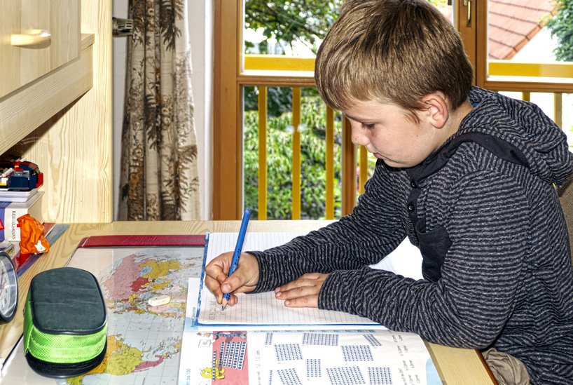 Boy doing schoolwork at home