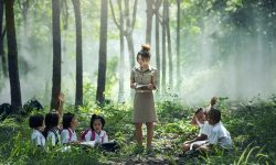 Teacher with students by a forest
