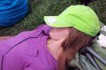 Teen girl asleep on ground