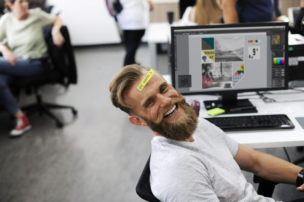 Man laughing at work