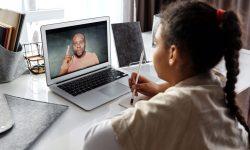 Child with teacher online