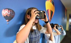 Students looking through goggles